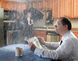 People in need of roof repair in New Sarpy LA. Leaky roof causing it to rain on people in their kitchen. Humorous.